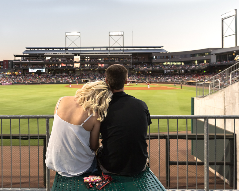 Couple watching from left field.